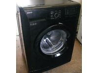 Black Beko 7kg load 1200 spin washing machine A+ energy rated