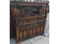 OLD CHARM COURT CUPBOARD/BUFFET LEADED GLASS DOOR AT TOP CARVED 3 DOORS 3 DRAWERS AT BOTTOM