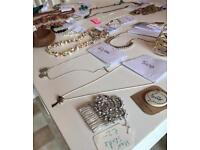 Assorted bracelets, badges and necklaces