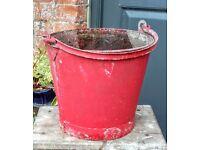 Vintage red galvanised bucket