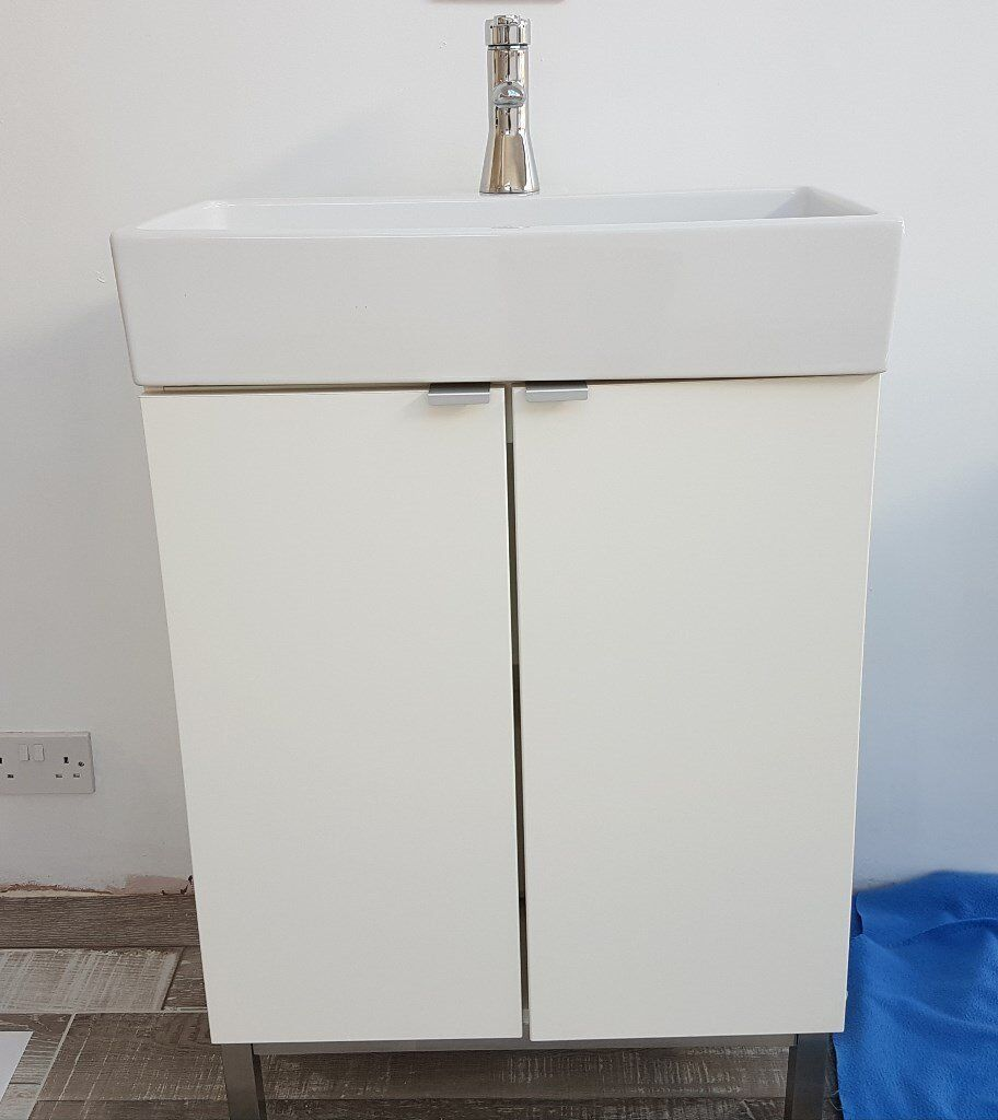 Free standing bathroom cabinet sink tap and toilet