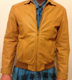 Vintage Leather Jacket (Mens). Medium size and lined. Front zip. 2 outside pockets and two inside.