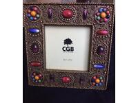 A vintage handmade Indian jewel frame,