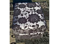 A New Designer Plum and Silver Floral Patterned Footstool.