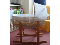 Moses basket with wooden rocker stand, hardly used, MANY SPARE SHEETS!