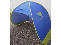 As new, Sun Sense pop up family sun shelter/tent. Provides 50+ U.P.F.