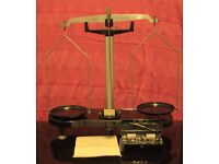 set of scales including paper work and weights