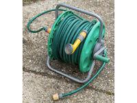 Hozelock 40m+ water hose, reel and sprinkler head.