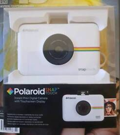 Polaroid Snap Touch instant camera with film.