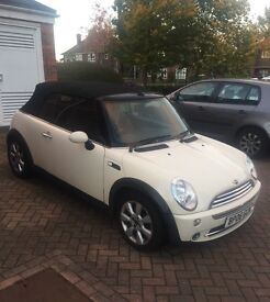 Much loved White Mini Cooper Convertible part leather interior.