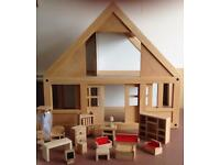 Wooden dolls house with a selection of furniture