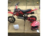 Brand new mini Moto with gloves and helmet age 14 years plus