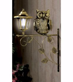 Metal owl with solar light
