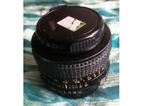 Minolta standard lens 50mm and wide angle 28mm - used - one case