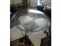 3 FOOT 6 INCH WIDE CLEAR GLASS DINING TABLE PLUS 4 SOLID METAL CHAIRS WITH COMFORT SEATING