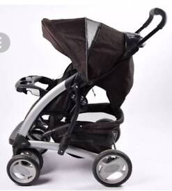 Graco deluxe pushchair in black and carseat