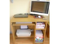 Computer Desk in Beech, with pull out shelf and storage. In very good condition.