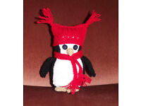 Handmade crochet penguin with hat and scarf