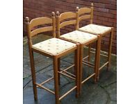 3 wooden kitchen stools. upholstered seats. In very good condition.