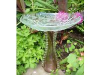 Bird feeders/baths. Unique hand made with glass from charity shops.