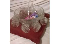 Glass punch bowl with glasses and ladel
