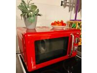 Swan 800W red microwave for sale.
