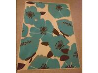 Teal, poppy rug from Very