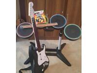 Xbox 360 guitar hero set (guitar.drums.sticks.game)