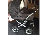 Mamas and papas pram and buggy system , dark brown check . Exc clean condition.