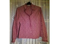 Vintage red and cream flowery shirt, with frill detail on the collar and sleeve.