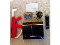 PS3 300GB WITH LOADS OF GAMES GUIDES AND ACCESSORIES