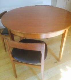 G Plan extendable round table and three chairs. Excellent condition.