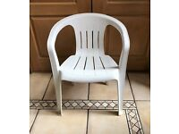 Set of 6 stackable white plastic garden chairs
