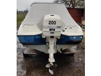 Bayliner power boat and trailer 200hp outboard
