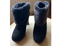 UGG boots size 5. High heel black Ugg ankle boots with grey fur trim