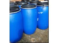 210 Plastic blue drums/barrels