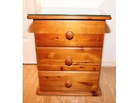 3 drawer wooden bedside cabinet with glass top