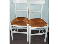 PAIR of WHITE CHAIRS Solid Wood with Wicker seats for kitchen or dining room. 2 matching.
