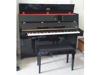 Black Kawai 15E upright piano with stool in very good condition