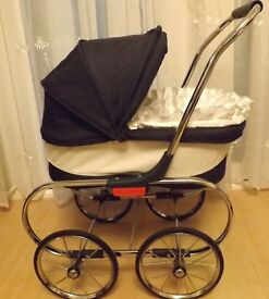 dolls pram for a boy doll ,in navy and cream ,with white and blue pram set ,