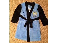Boys Manchester City dressing gown. Age 2-3. Brand new with tags
