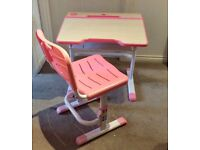 Child's adjustable Desk and chair pink. Used excellent condition. Shelf and