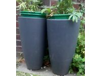 planters. 1 stone. 2 plastic poly. all grey for your planting.patios gardens