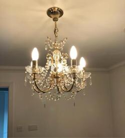 Crystal chandelier and 2 matching wall lights
