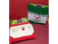 Hand knitted Matchmakers Christmas covers.