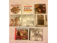 8 x Beatles CD's