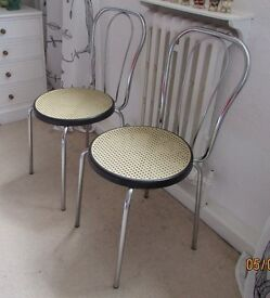 Two Chrome & Faux Rattan Style Dining Chairs with Black Contrast