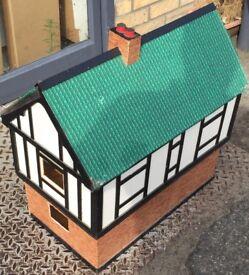 An old mock Tudor dolls house