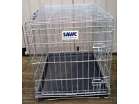 For sale is a used medium sized heavy gauge folding Silver Galvanised metal Dog / Pet cage