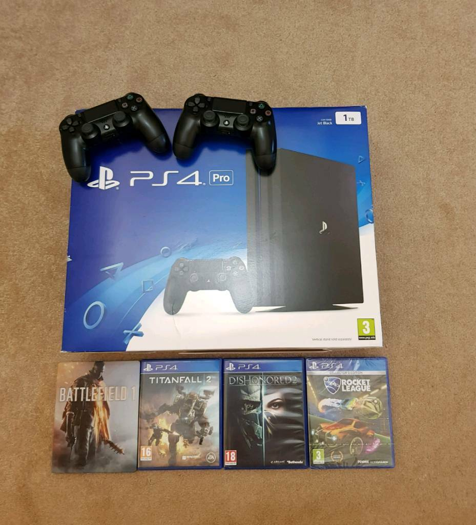 PS4 PRO 1TB, 2x controllers, 4x games